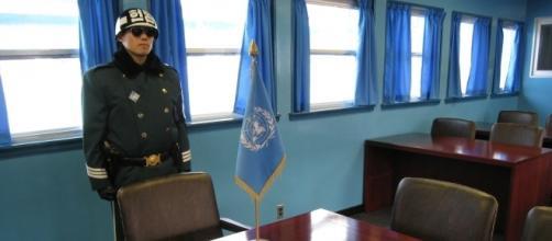 North Korean soldier in conference room at North/South Korean border. / [Image by Pontamax via Pixabay, CC BY 0]
