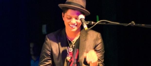Bruno Mars performs during a concert in Houston (Brothers Le/Flickr).