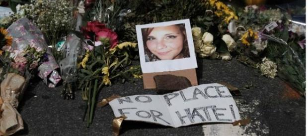 Heather Heyer's photograph is shown with a message and bunches of flowers (Facebook).