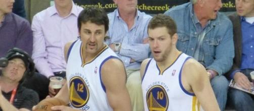 Andrew Bogut and David Lee are among the unsigned NBA veterans who could help an NBA title contending team - Matthew Addie via Wikimedia Commons