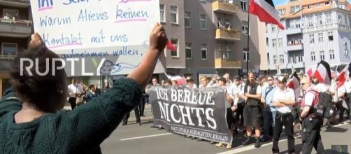 A counter-protester stands against a group of neo-Nazis in Spandau, Berlin [Image: YouTube/Ruptly TV]