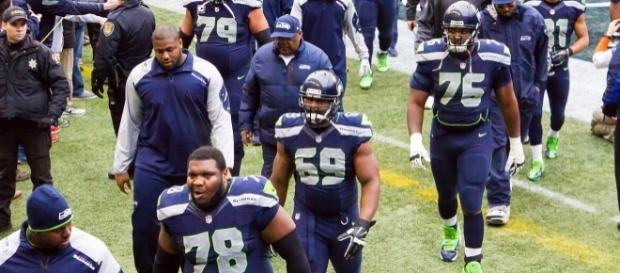 Seattle Seahawks linemen and receivers in 2013 [Image by Mike Morris|Wikimedia Commons| Cropped | CC BY-SA 2.0 ]
