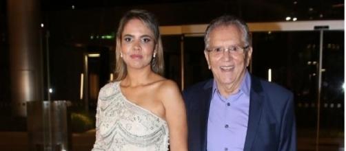 Renata Domingues e Carlos Alberto em encontro social