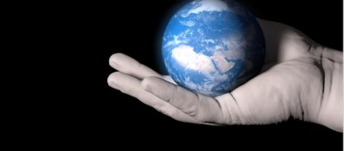 We only have one planet to care for, so why aren't we caring enough? (Image Credit: Our Planet On A Palm via Public Domain Pictures)