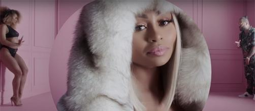 Blac Chyna keeps herself busy at work, appearing in Belly's new music video. (YouTube/Belly)