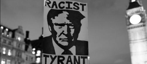 Trump sign at protest in England. / [Image by Alisdare Hickson via Flickr, CC BY-SA 2.0]