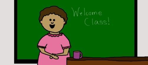 Teacher in class: Image via Pixabay.
