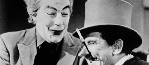 Cesar Romero (L) as the first live-action Joker, in the 'Batman' 60s TV series. / from 'Wikimedia Commons' - commons.wikimedia.com