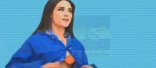 Garota tirou a roupa enquanto apresentava a previsão do tempo (foto: Captura de vídeo)