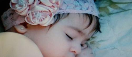 Bebê com fita na cabeça (foto: Repórter Pilar do Sul)