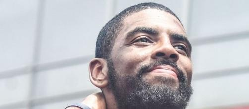 Kyrie Irving receives support from Udonis Haslem. (Image credit: Erik Drost/WikiCommons)