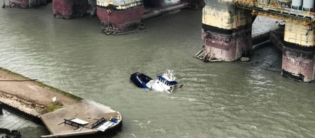 Coast Guardsmen rescue 15 people in distress aboard three vessels after Hurricane Harvey made landfall near - department of defence