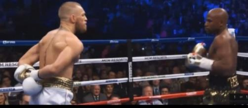 Conor McGregor taunting Floyd Mayweather in round 1. Mayweather would beat him later by TKO. / from 'YouTube' screen grab