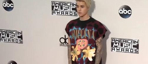 Justin Beiber speaks out following canceled world tour. Image via YouTube/ET