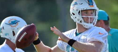 Ryan Tannehill injured in Dolphins training camp - (Image credit: YouTube|ESPN)