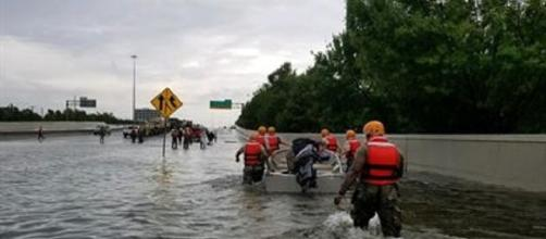 National Guardsmen slog through a flooded Houston road (Defense Department)