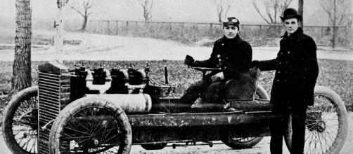 Henry Ford is the father of the mass market automotive industry as we know it today - Henry Ford & Barney Oldfield in 1902 via Wikimedia Commons