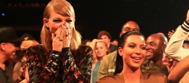 Taylor Swift and Kim Kardashian together. (image source: YouTube/Clevver News)