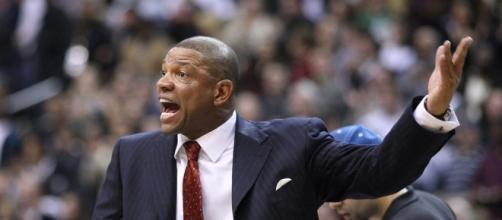 Doc Rivers will still earn his salary of over $10 million this season for his two roles -- Keith Allison via WikiCommons
