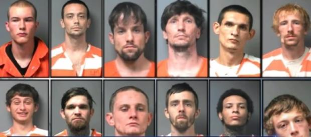 A photo showing the 12 Alabama inmates who were able to escape using peanut butter - YouTube/NBC News