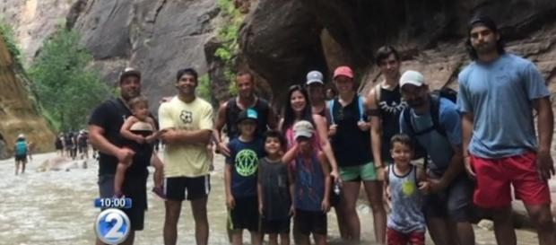 Jhonatan Gonzalez and his family formed a human chain to help hikers across the flash-flooded river [Image: YouTube/KHON2 News]