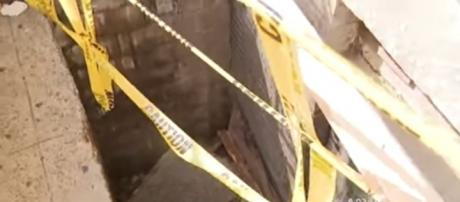 Woman falls six feet down a hole when the sidewalk collapsed [Image: YouTube/CBS New York]