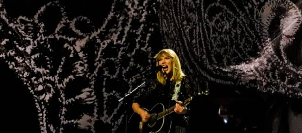 Taylor Swift is expected to appear at a court trial to provide her testimony against a DJ. [Image Credit: Wikipedia Commons]