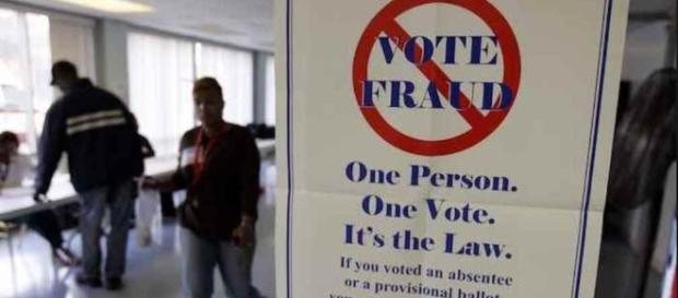 Sign warning against voter fraud. (YouTube snipped)