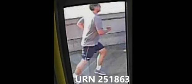 A London jogger deliberately pushed a woman in front of a bus [Image: YouTube/RT UK]
