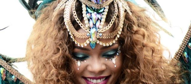 Rihanna in her aqua colored hair and mini shorts in Barbados - Screenshot via RihannaVEVO – YouTube