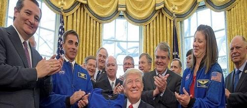 President Donald Trump with NASA personnel / Photo via NASA/Bill Ingalls , Wikimedia Commons