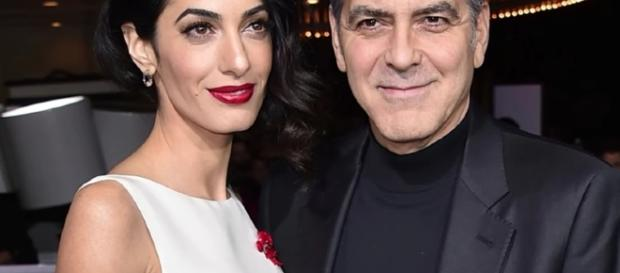 George and Amal spend time with Amal's mother through a dinner. Image via YouTube/Wochit