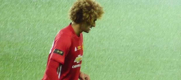 Is Marouane Fellaini going to stay at Old Trafford? (Image: Wikimedia Commons/Ardfern)