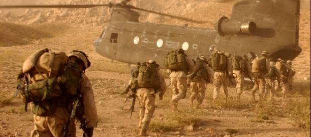Soldiers march to the ramp of the CH-47 Chinook helicopter on Sept. 4, 2003 by Staff Sgt. Kyle Davis via Wikimedia Commons