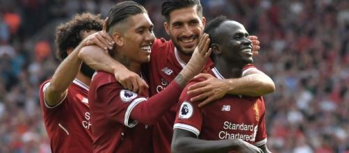 Liverpool players celebrate a goal wikimedia.org