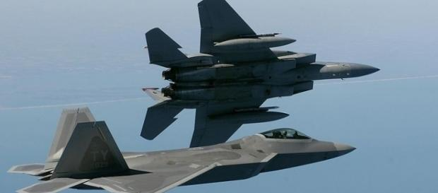An F-15 Eagle and an F/A-22 Raptor in flight (Credit - Ben Bloker – wikimediacommons)