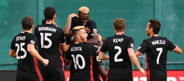 DC United player celebrate a goal against New England wikimedia.org