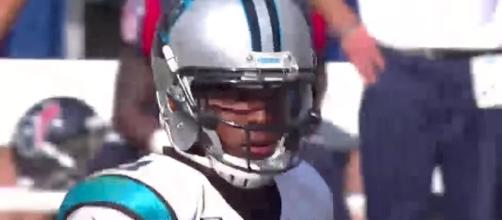 Cam Newton and the Panthers visit the San Francisco 49ers on Sunday afternoon. [Image via NFL/YouTube]