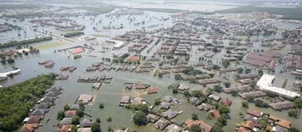 Hurricanes carring heavy rains and high winds devastation of lives and property. [Image via South Carolina National Guard/Wikimedia Commons]