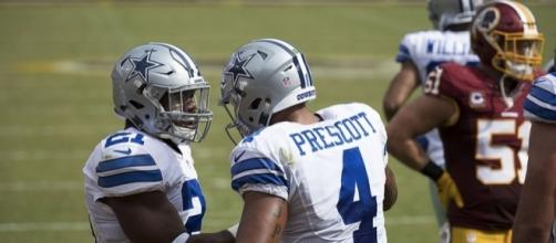 Dallas Cowboys' Dak Prescott and Ezekiel Elliott alongside each other. Image Credit: Keith Allison, Flickr -- CC BY-SA 2.0