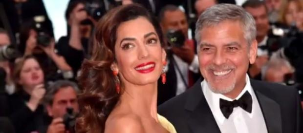 George Clooney threatens prosecution over photos of twins. - Image Credit: CBS News/YouTube