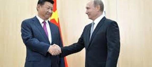 Russia and China backed sanctions. https://upload.wikimedia.org/wikipedia/commons/7/73/Vladimir_Putin_and_Xi_Jinping%2C_BRICS_summit_2015_01.jpg