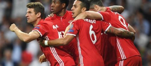 Bayern Munich players celebrate a goal wikimedia.org