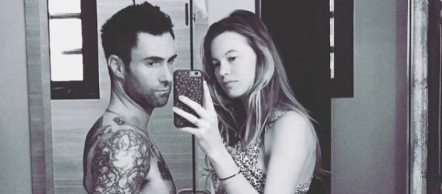 Adam Levine poses with a pregnant Behati Prinsloo. [Photo via Instagram]