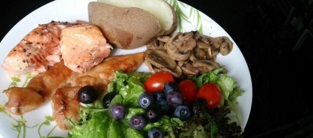 Eat healthy meals, like this plateful of mushrooms, salad, potatoe, tomato, salmon and berries (ProjectManhattan/Wikimedia Commons).