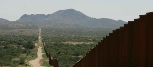 A long border wall similar to the proposed Mexican-American border wall. Source; commons.wikimedia.com
