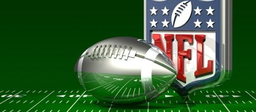 C_osett Follow Silver Football and NFL Logo On Top of a Green Field - CCO Public Domain | Flickr