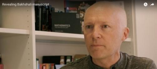 "Oxford's Marcus du Sautoy explains carbon-dated Bakhshali manuscript, with oldest known origins of ""zero."" / Photo via Science Museum on YouTube."