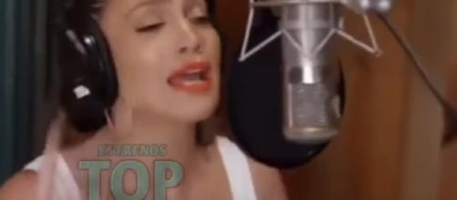 Jennifer Lopez teases new Spanish album in works. YouTube/TopLatinoEstrenos