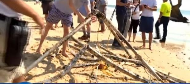Mysterious metal object was found off a Rhode Island beach [Image: YouTube/CBS Boston]